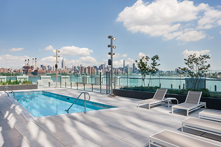 Outside pool with skyline of New York - 1N4 Williamsburg New York